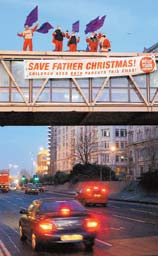 Fathers 4 Justice members dressed as Father Christmases on the Strand bridge, Liverpool