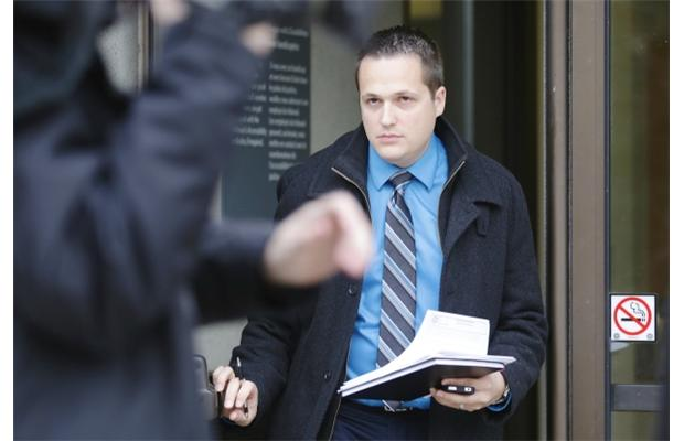 Ottawa police Det. Jean-Luc Bonin exits the Elgin St.reet courthouse in Ottawa on Friday, November 15, 2013. Bonin, who testified at a bail hearing today, is one of the investigators in the sexual assault case  involving the woman and a taxi driver Saturday, Nov. 9, 2013.