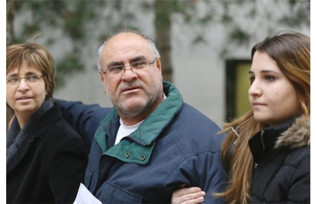 Suspended taxi driver Nidal Zeiti, 52, walks outside the Elgin Street courthouse with his wife Sana Daod and 20-year-old daughter after receiving bail in Ottawa on Friday, November 15, 2013.
