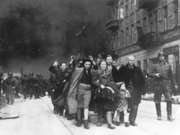 In this 1943 file photo, a group of Polish Jews are led away for deportation by German SS soldiers during the destruction of the Warsaw Ghetto by  German troops after an uprising in the Jewish quarter.