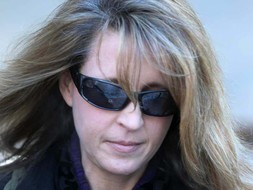 Ottawa teacher's aide Kathy Kitts leaves the courthouse in Ottawa on Thursday. Kitts pleaded guilty to sexually exploiting a male student for two years.